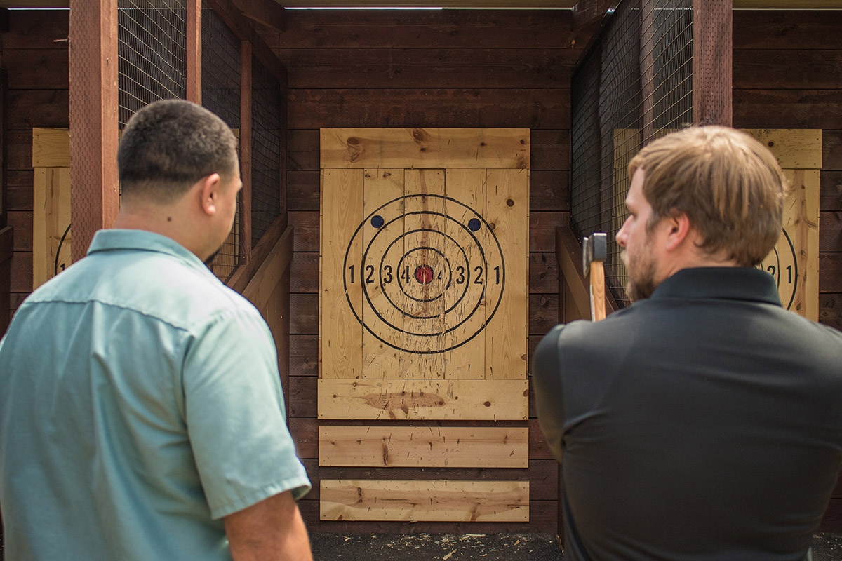Axe throwing coaching a guest