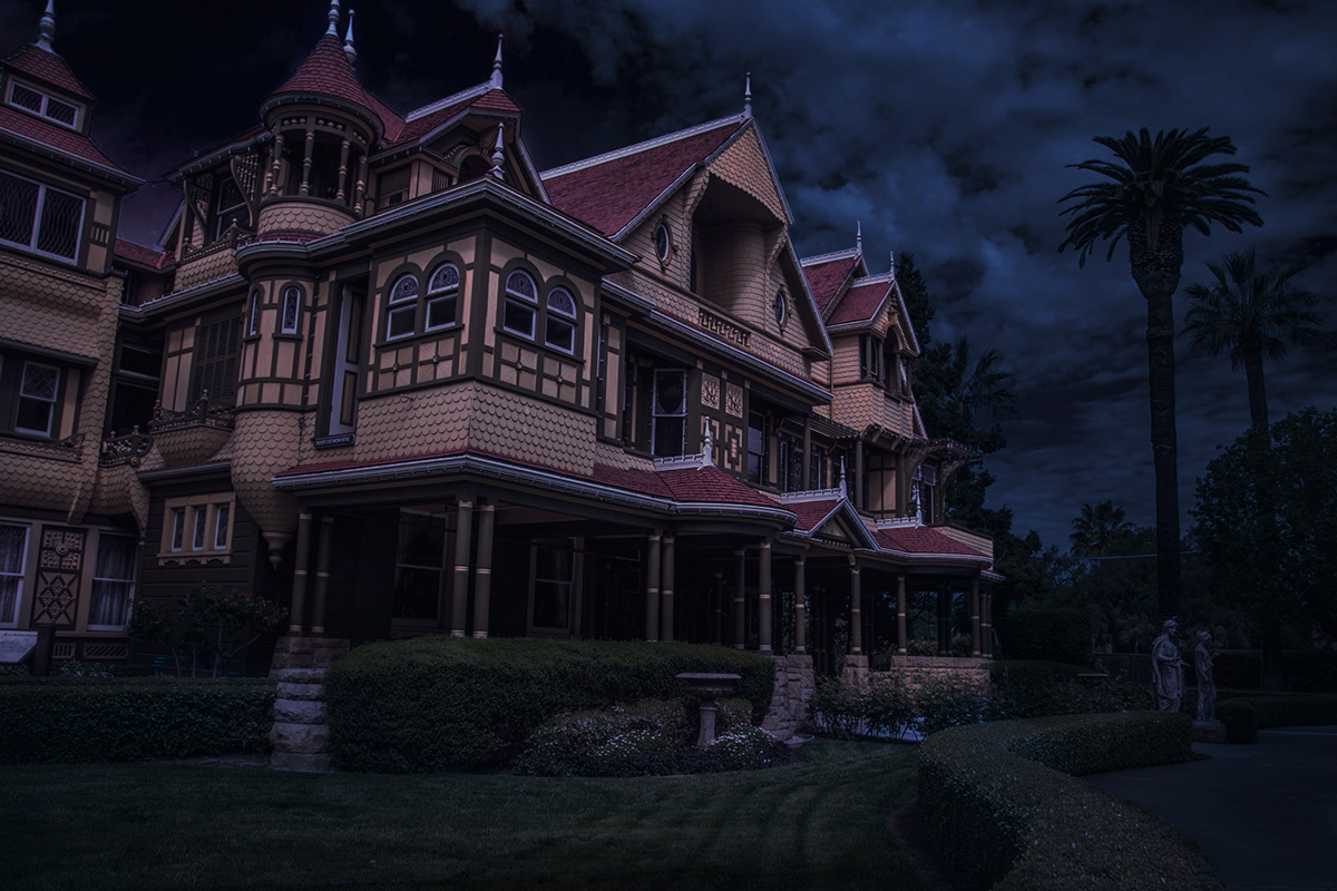 Spooky night time photo of the winchester mystery house for halloween