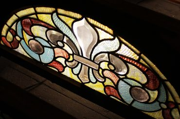 image of a stained glass window at sarah winchesters beautiful estate
